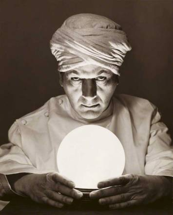 Close-up of a fortune teller looking into a crystal ball